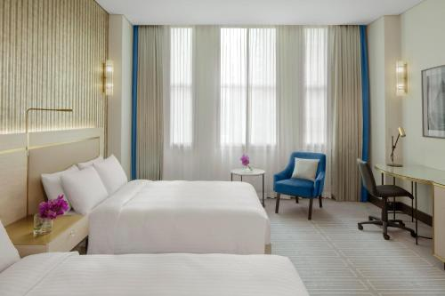 A bed or beds in a room at Radisson Blu Plaza Hotel Sydney