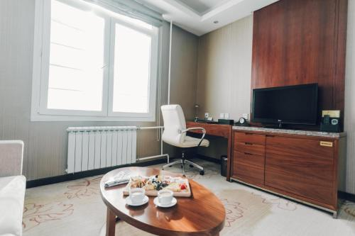 A television and/or entertainment center at Soluxe Hotel Almaty