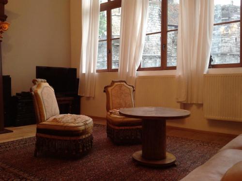A seating area at Geldmunt Apartment