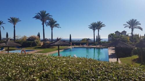 The swimming pool at or near Heart of Marbella Los Flamingos