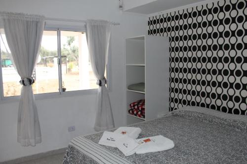 A bed or beds in a room at Posada de Campo Pura Vida