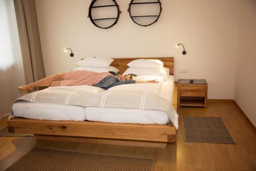 Ein Bett oder Betten in einem Zimmer der Unterkunft Pension Schüssler