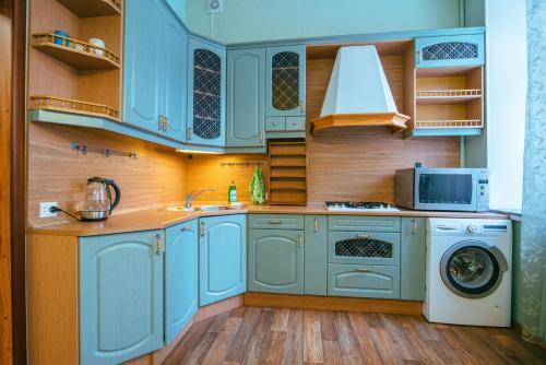 Кухня или мини-кухня в RentPiter Griboedova 93 balcony