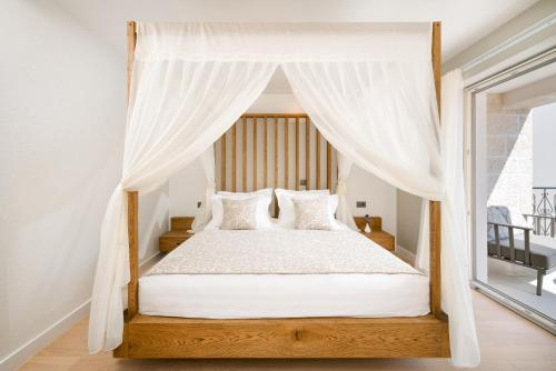 A bed or beds in a room at Villa Basca