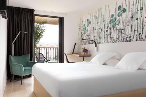 Un ou plusieurs lits dans un hébergement de l'établissement Best Western Hôtel Alcyon
