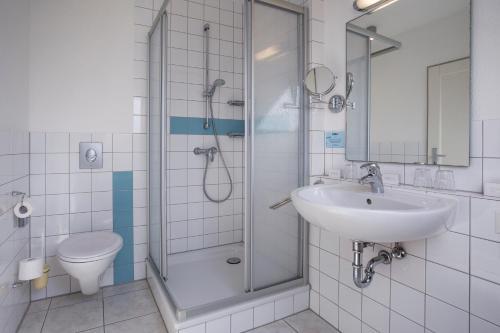A bathroom at TUI BLUE Sylt