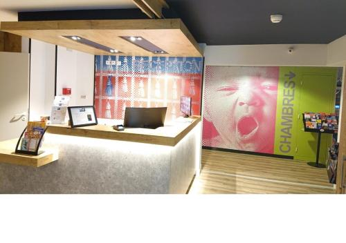 The lobby or reception area at Hotel Ibis Budget Montpellier Centre Millenaire -