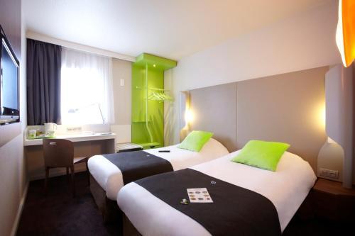 Un ou plusieurs lits dans un hébergement de l'établissement Campanile Lyon Ouest Tassin