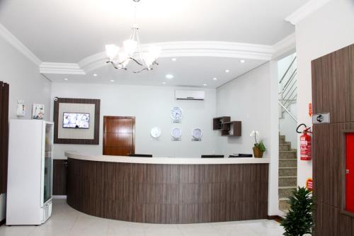 O saguão ou recepção de Miotto Executive Hotel