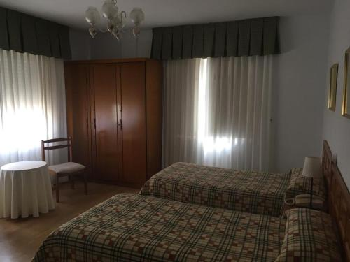 A bed or beds in a room at Hotel Las Dunas