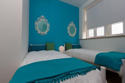 A bed or beds in a room at Turismo do Seculo