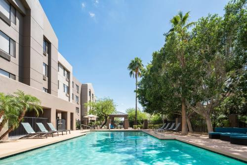 The swimming pool at or near SpringHill Suites Scottsdale North