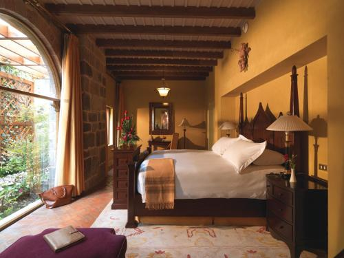 A bed or beds in a room at Monasterio, A Belmond Hotel, Cusco