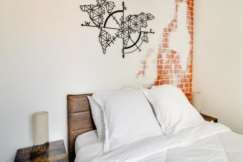 Un ou plusieurs lits dans un hébergement de l'établissement Vintage Lodge - SDP