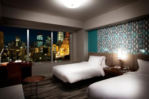 A bed or beds in a room at The Prince Park Tower Tokyo