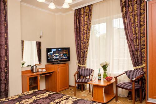 Телевизор и/или развлекательный центр в Отель Фрегат