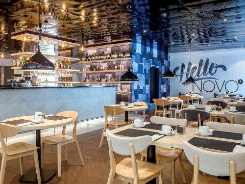 A restaurant or other place to eat at Novotel Szczecin Centrum