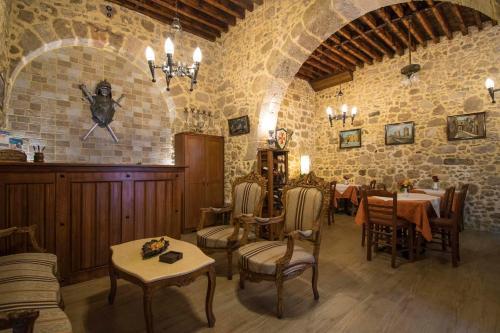 En restaurant eller et spisested på D'Argento Boutique Rooms