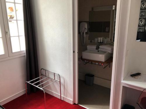 Salle de bains dans l'établissement Hotel Reine Mathilde