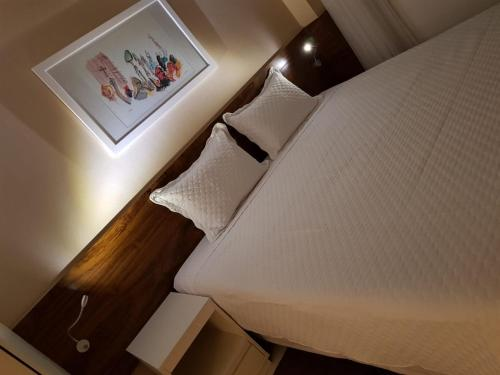 A bed or beds in a room at Flat aconchegante no SHN