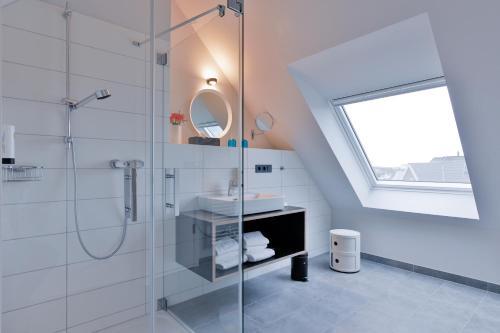 Ein Badezimmer in der Unterkunft Bett&Bude Boardinghouse