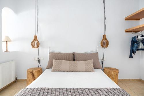 Un ou plusieurs lits dans un hébergement de l'établissement Ornos Blue