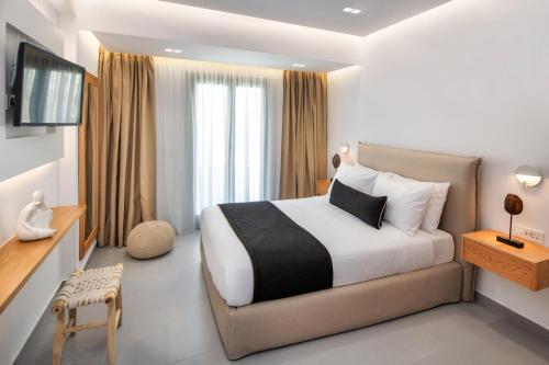 Letto o letti in una camera di Harmony Suites