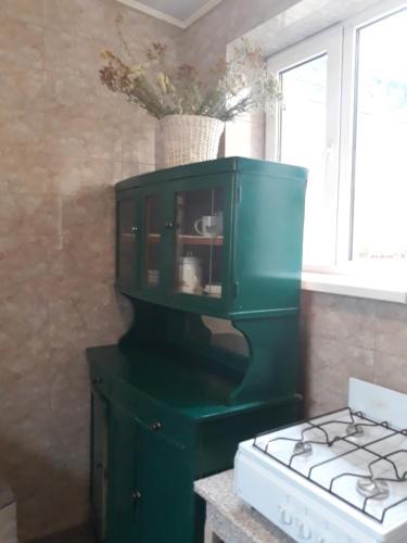 Телевизор и/или развлекательный центр в Guest House on Zhukova