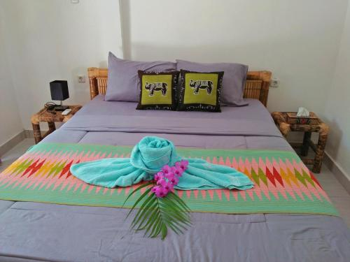 A bed or beds in a room at Tropical Garden Inn