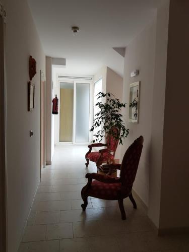 Zona de estar de Apartamentos Hacienda de Arna