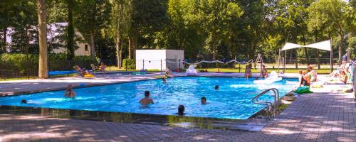 The swimming pool at or close to Holiday Suites Houthalen-Helchteren