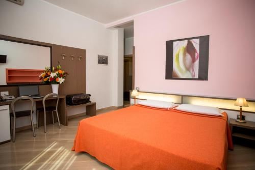 A bed or beds in a room at Hotel Fiera Congressi