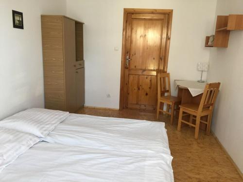 Łóżko lub łóżka w pokoju w obiekcie Anielskie Pokoje
