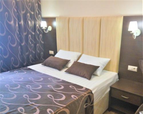 Кровать или кровати в номере Апартаменты