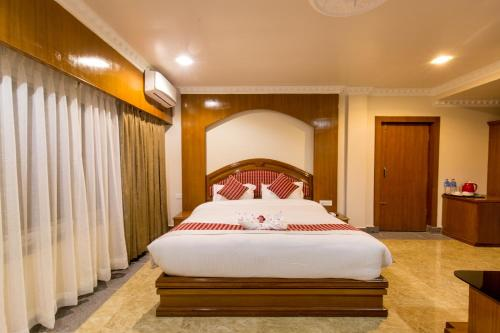 A bed or beds in a room at Hotel Earth Light Sauraha