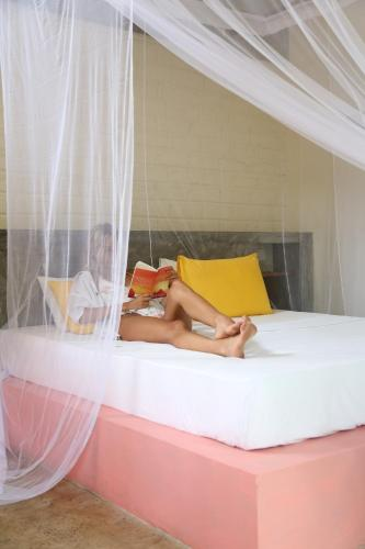 A bed or beds in a room at BoHo Hiriketiya