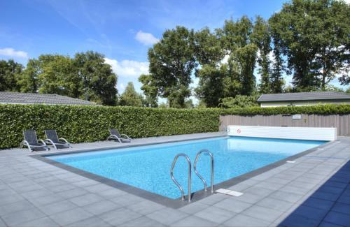 The swimming pool at or near DL Deluxe 6 personen