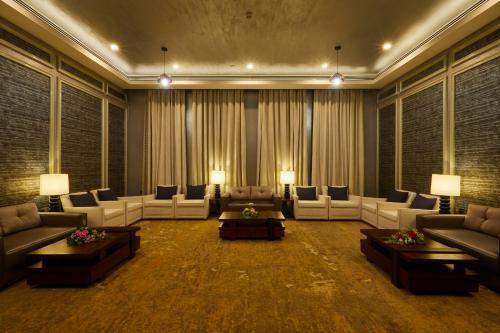 منطقة جلوس في Millennium Resort Salalah