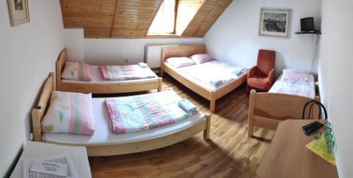 Postel nebo postele na pokoji v ubytování Penzion Na Bařinách