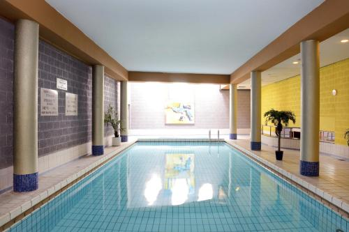 The swimming pool at or near Amrâth Grand Hotel de l'Empereur