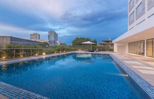 The swimming pool at or near Park Inn By Radisson Iloilo