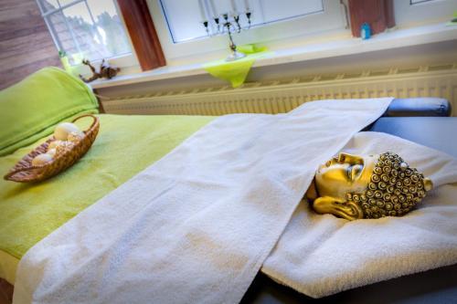 Ein Bett oder Betten in einem Zimmer der Unterkunft Ferien Hotel Spreewald