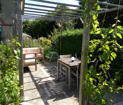 A porch or other outdoor area at La Maison Du Marchand