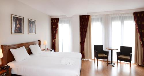 Een bed of bedden in een kamer bij Amrâth Grand Hotel Frans Hals