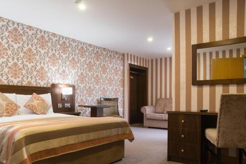 A bed or beds in a room at Holyrood Hotel - Leisure Centre & Escape Spa