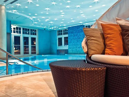 Der Swimmingpool an oder in der Nähe von Travel Charme Strandidyll Heringsdorf