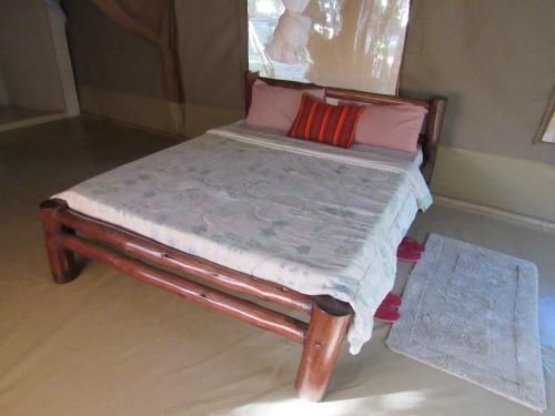 A bed or beds in a room at Enchoro Wildlife Camp
