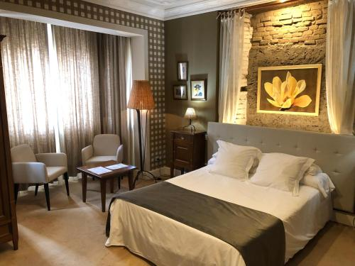 A bed or beds in a room at Marina de Campios