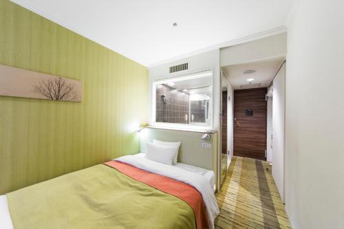 吉祥寺第一ホテルにあるベッド