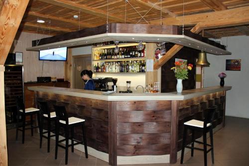 The lounge or bar area at Imantas nams